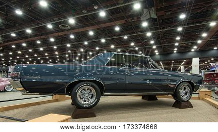 DETROIT MI/USA - February 24 2017: A 1965 Pontiac GTO car restoration on display at the Detroit Autorama, a showcase of custom and restored cars.