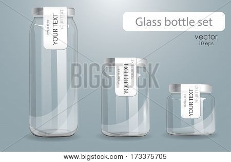 Set of transparent glass bottles. Realistic banks. Isolated on a gray background. Set of different size cans with decals. Labeled cans for dairy products
