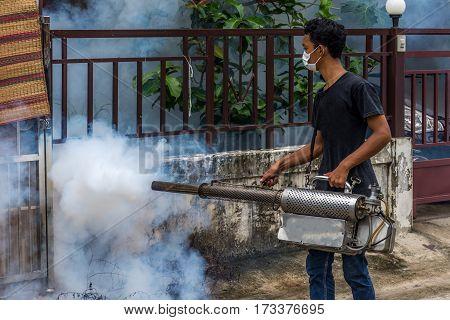 People fogging DDT spray kill mosquito for control Malaria Encephalitis Dengue and Zika in village at Bangkok Thailand.