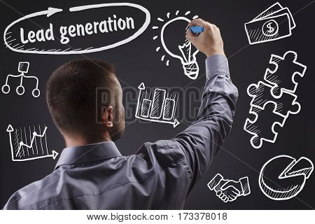 Technology, Internet, Business And Marketing. Young Business Man Writing Word: Lead Generation