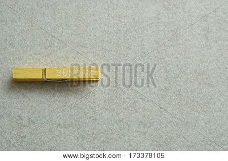 Sunday written on a cloth peg isolated on a white background