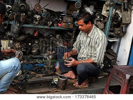 KOLKATA, INDIA - FEBRUARY 08: Streets of Kolkata, mechanic at workshop on Malik Bazaar, on February 08, 2016 in Kolkata, India