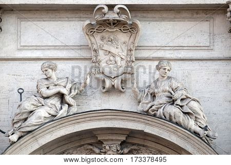 ROME, ITALY - SEPTEMBER 01: Coat of arms of Cardinal Francesco Peretti on the portal of Sant Andrea della Valle Church in Rome, Italy on September 01, 2016.