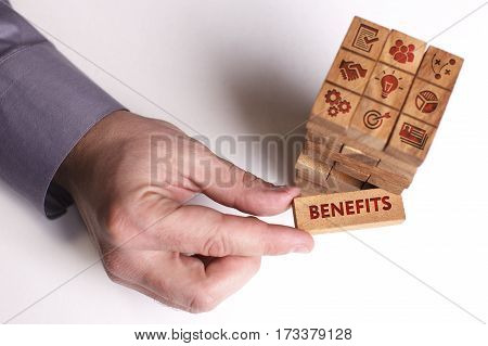 Business, Technology, Internet And Network Concept. Young Businessman Shows The Word: Benefits