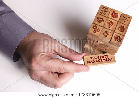 Business, Technology, Internet And Network Concept. Young Businessman Shows The Word: Property Manag