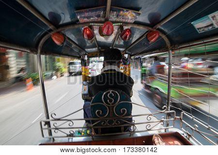 Thai traditional tuk tuk from Bangkok Thailand in motion blur