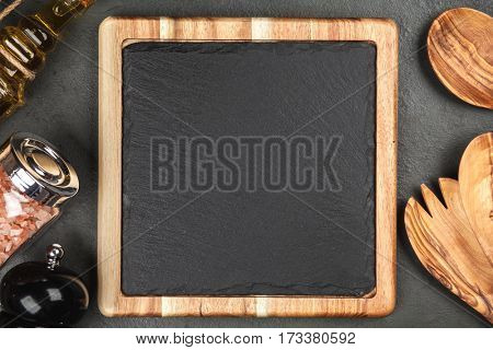 Slate board in a wooden frame background