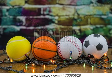 Sports balls souvenirs against the background of a color wall