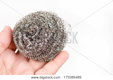 Cleaning Wire In The Hand Over White Background