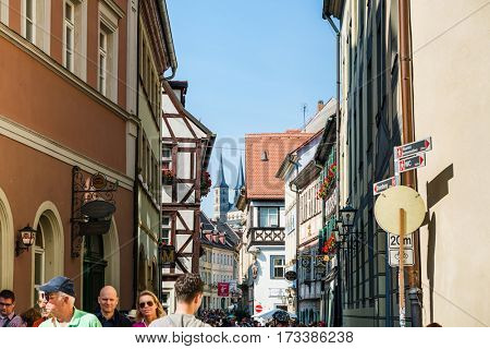 BAMBERG, GERMANY - Circa September, 2016: Narrow street in Bamberg with tourists and historic medieval buildings.