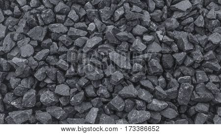 Grainy crushed building rubble texture background image.
