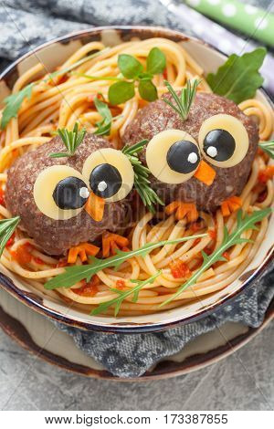 Pasta spaghetti with funny meatballs for kids. Birds in nests