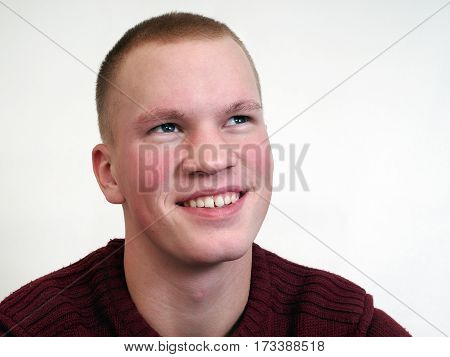 sincere happy smile on the face of the young man. Portrait. White background