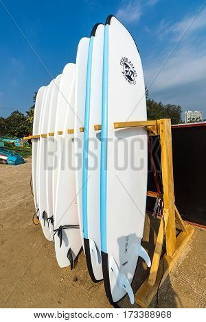 WELIGAMA SRI LANKA - JANUARY 12 2017: Set of different color surf boards in a stack by ocean.WELIGAMA SRI LANKA. Surf boards on sandy Weligama beach. On Weligama beach surf is available all year around for beginner and advanced.