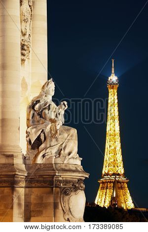 PARIS, FRANCE - MAY 13: Eiffel Tower and statue at night on May 13, 2015 in Paris. With the population of 2M, Paris is the capital and most-populous city of France