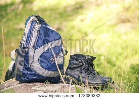 backpack and shoes backpackers in the grass