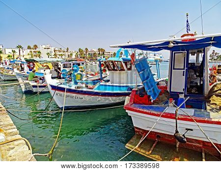 Kos, Greece - July 31, 2015: In the port of Kos in Greece some small fishing boats are moored after returning from fishing.