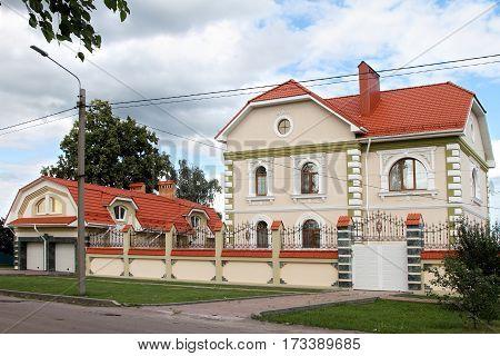 BORISOGLEBSK VORONEZH OBLAST RUSSIA- JULY 21 2015: Modern stone house on the street.