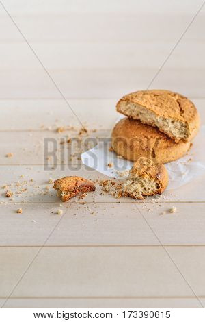 Dessert. Fresh delicious cookies on a wooden table. Crumbs on the table. Sweet Home a cozy family home morning.