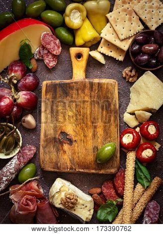 The Ultimate Appetizer Board with cheese and meat.