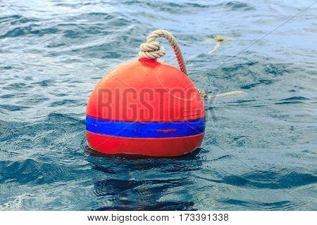 Orange buoy on the blue sea, Thailand