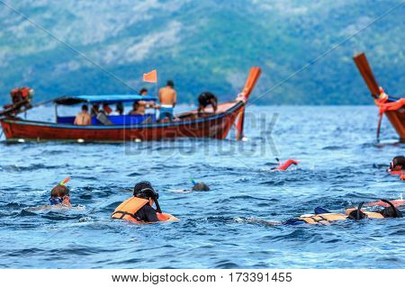 Snorkeling activity of tourists with life jackets with life jacket Lipe Thailand