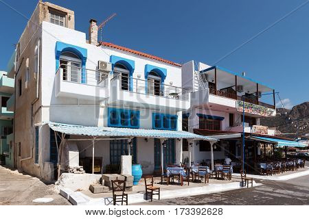 PALEOCHORA, CRETE, GREECE - JUNE 2016: Traditional Greeke with house with tavern on first fool.