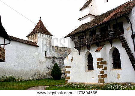Courtyard of the old medieval fortified saxon church in the village Harman - honigberg, Transylvania, Romania