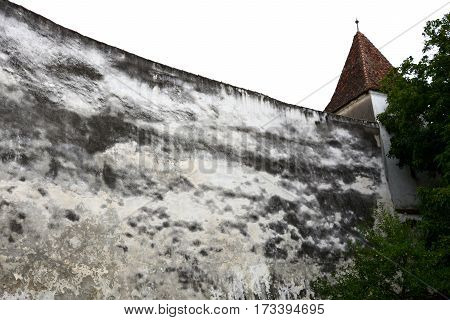 Walls of the old medieval fortified saxon church in the village Harma, Honigberg, Transylvania, Romania.