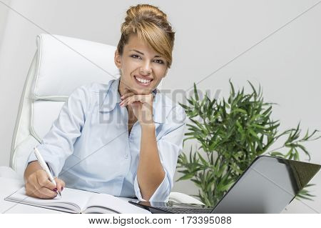 Young business woman in her office. Concept