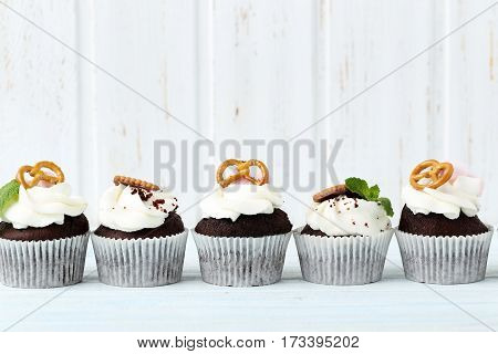 Chocolate Cupcakes On A Blue Wooden Table