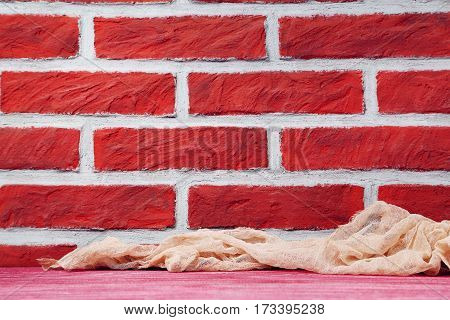 Beige Gauze Fabric On A Brick Wall Background