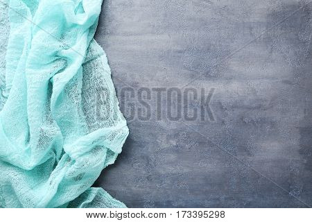 Mint Gauze Fabric On Grey Wooden Table