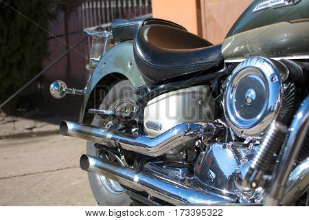 Subotica, Serbia -February 25,2017:Green Yamaha Drag Star 1100 motorcycle in front of the garage, photographed on a nice sunny day. Ready for restoration.