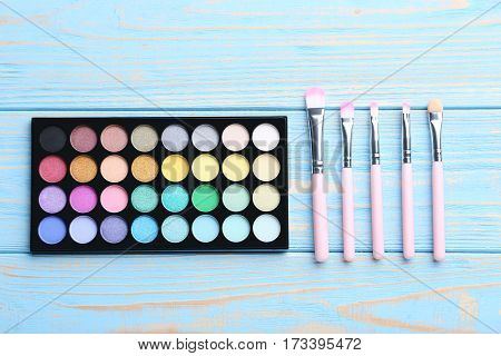 Makeup Cosmetics On A Blue Wooden Table