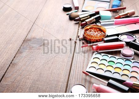 Different Makeup Cosmetics On Brown Wooden Table