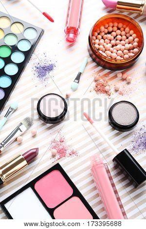 Different makeup cosmetics on the paper background