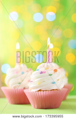 Tasty Cupcakes With Candles On Lights Background