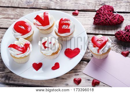 Tasty Cupcakes On A Brown Wooden Table