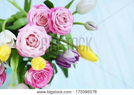 Bouquet Of Beautiful Roses And Tulips On Mint Background