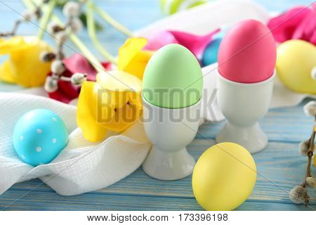Easter Eggs With Tulips On A Blue Wooden Table