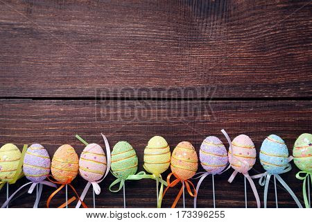 Easter eggs on a brown wooden table