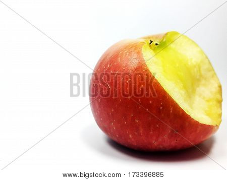 Bitten apple red on a white background.