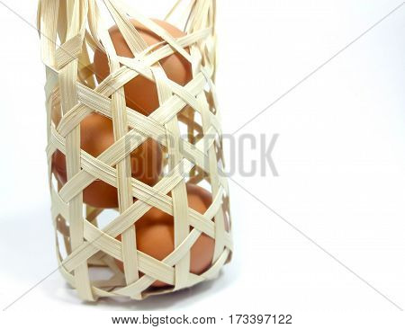 Three eggs, raw or cooked in the basket.