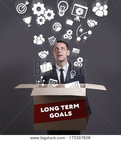 Business, Technology, Internet And Network Concept. Young Businessman Shows The Word: Long Term Goal