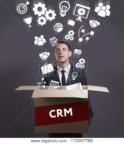 Business, Technology, Internet And Network Concept. Young Businessman Shows The Word: Crm