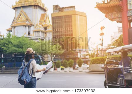 Young Woman Traveler Looking The Map In Bangkok China Town