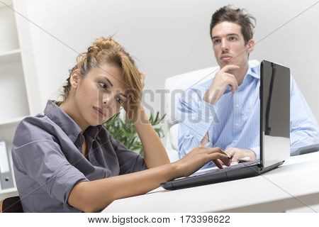 Two business people thinking in the office