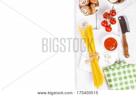 Italian spaghetti mushrooms tomato sauce cherry tomatoes and spices on a white background