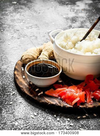 Asian Food. Boiled Rice With Soy Sauce And Pickled Ginger. On An Old Rustic Background.